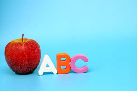 English ABC alphabet letters next to the red apple. Learning foreign language. English for beginners.