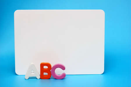 ABC - the letters of the English alphabet near the white Board. Concept of education. Copy space.