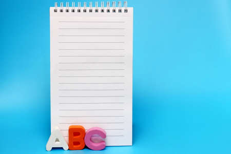 ABC-the first letters of the English alphabet on a blue background. Empty space for text. Blank Notepad page