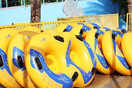 Pattaya, Thailand - 3 April 2019. Water park. Yellow inflatable rafts for the water Park. Safety on the water concept.