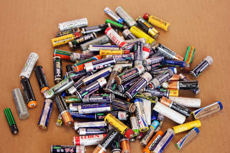 Russia, Vladivostok, November 05, 2020: A bunch of old used batteries from different brands. They need to be disposed of. Concept of environmental protection from pollution.