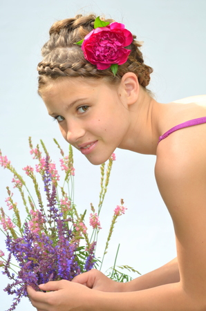 braids: Hairstyle with French braids and peony