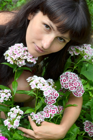 beautiful bangs: Girl with Sweet William Stock Photo