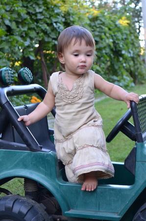 girlie: Little girl in an electric car