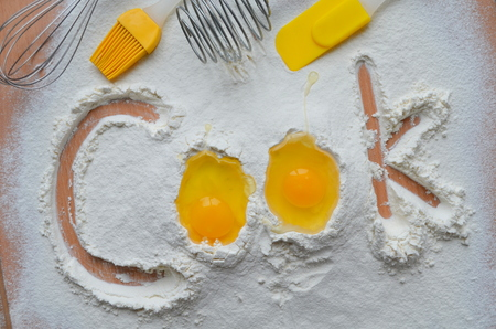 down beat: Flour and two eggs - the inscription Cook Stock Photo