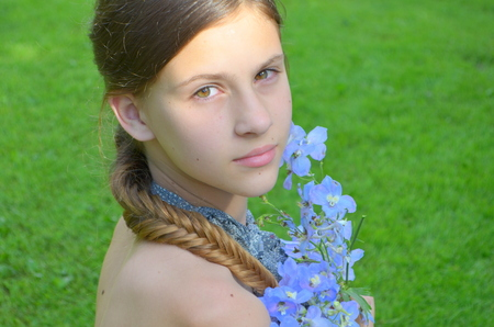fishtail: Girl with long braided hair - hairstyle fishtail