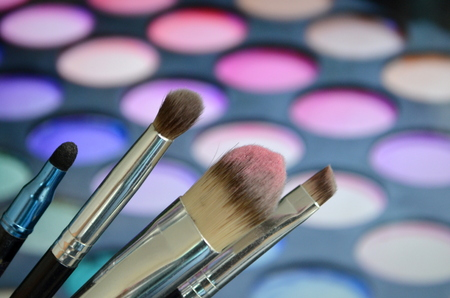 eyeshadow: Brushes for make-up on a background palette with eyeshadow