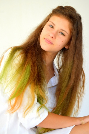 strands: Girl with long hair dyed with colored strands Ombre