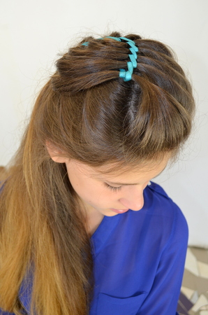 hair weave with blue ribbon