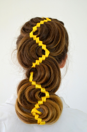 hair weave with yellow ribbon