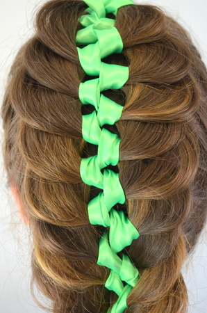 Hairstyle with long hair - braided ribbon in her hair Фото со стока - 64632263