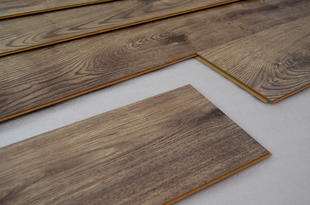 tabular: Installing laminate flooring Stock Photo