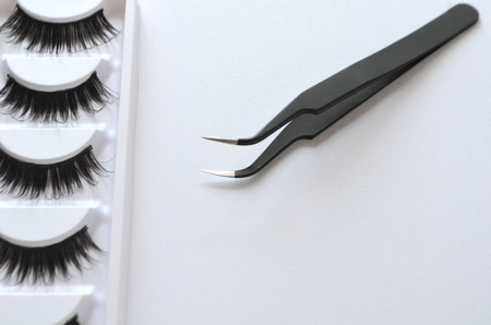 Eyelash technician one cilium, tweezers and artificial eyelashes