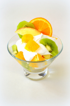 Dessert - fruit with cream, kiwi, apple and orange