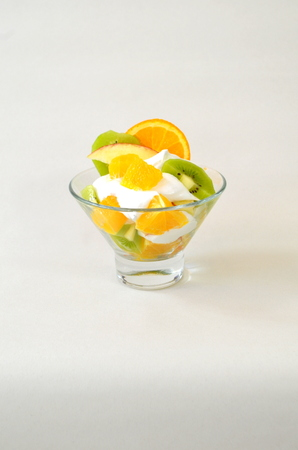 Dessert - fruit with cream, kiwi, apple and orange