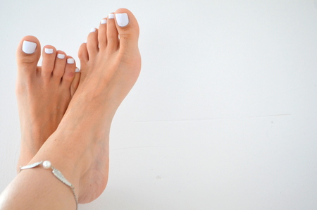 Female legs - white pedicure