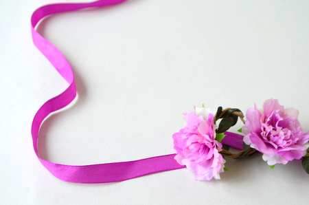 Background with a purple ribbon and flowers Lizenzfreie Bilder