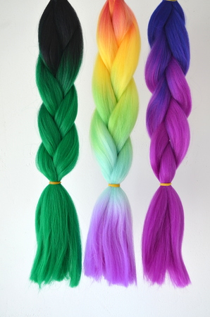 Kanekalon. Colored artificial strands of hair. Material for plaiting braids. Stock Photo