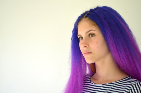 Girl with blue purple hair. Technique of hair extensions kanekalon nodular way. Ombre