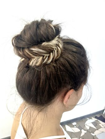 Hairstyle on long hair, braiding Stock Photo