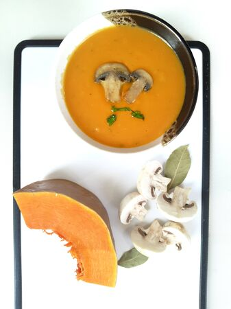 Cream soup with pumpkin and mushrooms