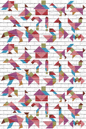 A lot of colorful figures laid out from a puzzle tangram, a wall with a brick texture Stock Photo