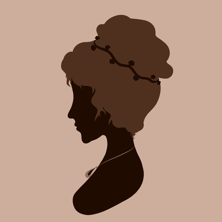 Silhouette of a beautiful woman with a festive hairdo Foto de archivo