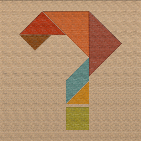 Question mark, laid out of geometric shapes, wood texture, tangram Stock Photo