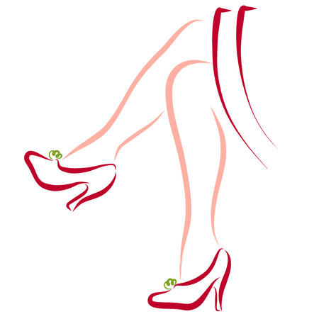 Slender female legs in fashionable high-heeled shoes