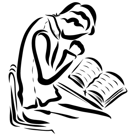 A young man studying the Bible and praying