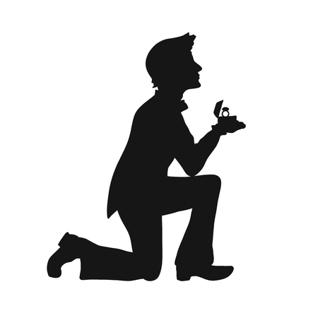 Silhouette of a loving man on his knees with a wedding ring Stock Photo