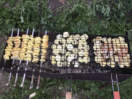 potatoes and chicken cooked on the grill