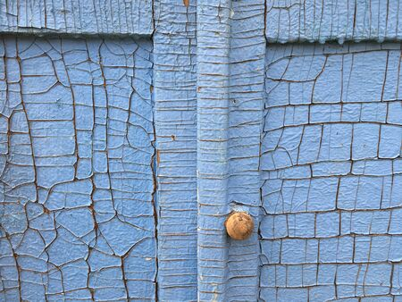 door knob on the cracked doors of vintage furniture