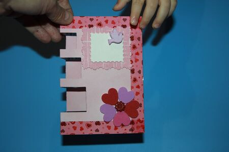 hand holding greeting card with dove and hearts