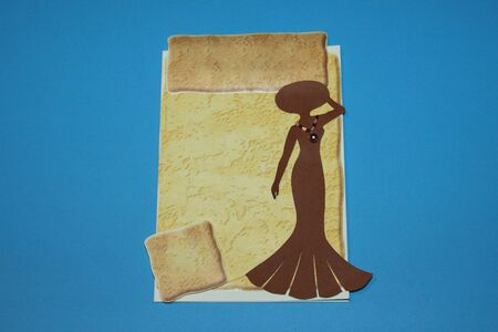 card with a silhouette of a girl with a beads