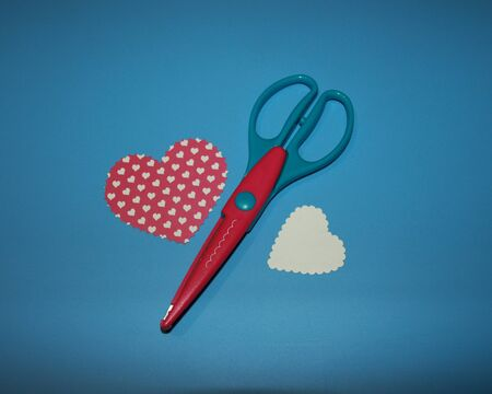 scrapbooking scissors, cloud pattern, cut out heart on colored paper with a heart pattern Stok Fotoğraf