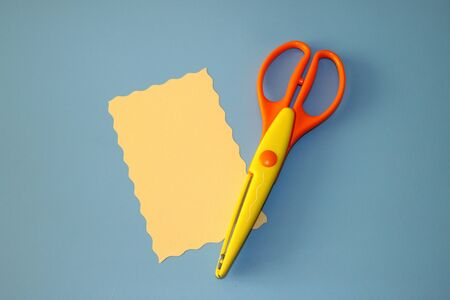 Rectangular scissors for cutting paper and pastel cardboard cut in the shape of a rectangle 写真素材 - 129825989