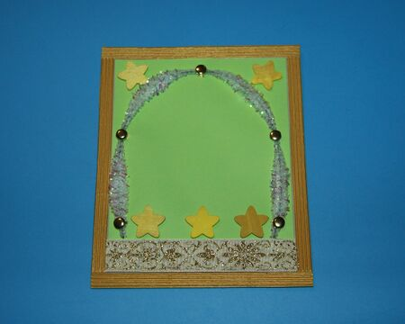 greeting card decorated with wooden stars, braid with ornament and chenille Zdjęcie Seryjne
