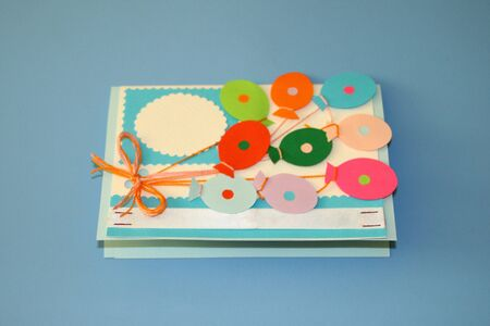 greeting card with balloons of different colors tied with a bow of fine thread and a place for recording Stok Fotoğraf