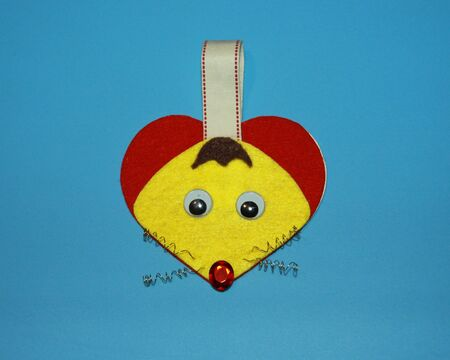 greeting card valentine's mouse in the shape of a heart and with a spring mustache