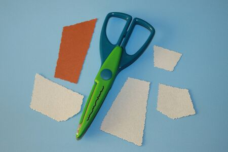 green and blue curly scissors for cutting paper wavy