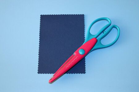 scrapbooking scissors, cloud pattern, rectangle cut out of colored paper Stok Fotoğraf