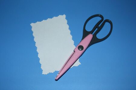 scrapbooking scissors, decorative contour pattern, rectangle cut out of paper