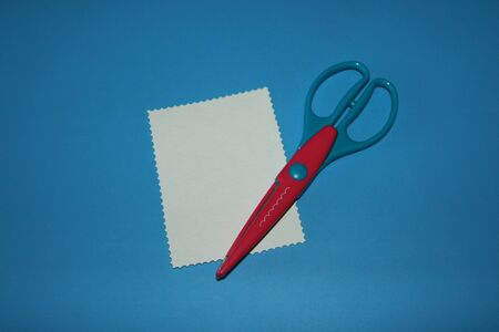 curly red and blue scissors for cutting paper wavy