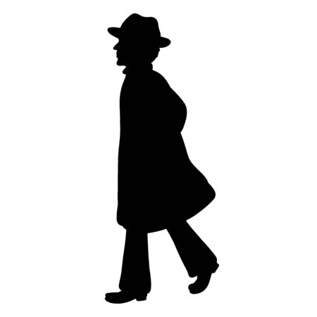 A man walking in a long coat and hat Zdjęcie Seryjne