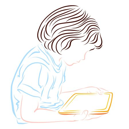 The child looks at the tablet screen Stock Photo