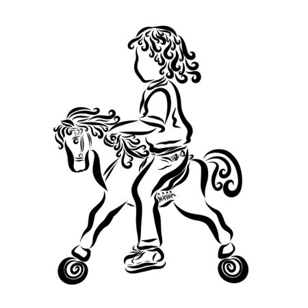 child riding a toy horse with wheels Stock Photo
