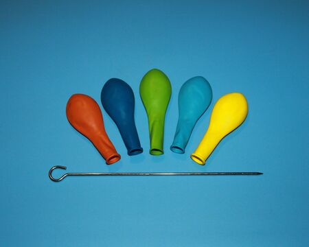 balloons red blue green light blue yellow and iron thin sharp, spear pin rod