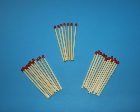 pile of wooden matches with a red tip head lie on a blue background Stock fotó