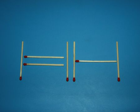 Wooden matches on a blue background laid out